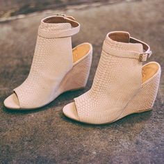 Pinky snakeskin booties with a peep toe and cutout heel. Gorg.