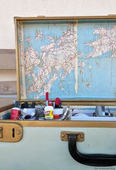 Top covered with maps, What's Inside the Vintage Suitcase? theboondocksblog.com
