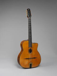 Jazz model (serial number 565) Mario Maccaferri (American, b. Italy, 1900–1993), designer; Henri Selmer Paris, maker  Guitar, Jazz model (serial number 565), 1942  Spruce, rosewood; 7 3/4 x 24 5/8 in. (19.7 x 62.5 cm)  Private Collection