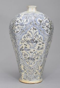 A LARGE OF BLUE AND WHITE MEIPING The exterior of the vase is decorated with numerous light blue colour flower and lotus blossoms. 19 3/8 in. tall. Yuan Dynasty