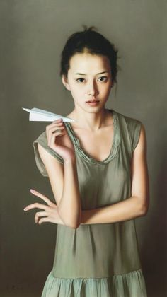 Artist: Li Gui Jun (李貴君), b. 1964 {contemporary figurative realism painter standing asian female paper airplane woman painting #loveart} <3