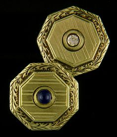 Foliate wreath borders, pinstripe centers, sparkling diamonds and rich blue sapphires.  An elegant example of the classic beauty and timelessness of the antique cufflink.  Created by Charles Keller & Co. in 14kt gold,  circa 1920.Art Deco