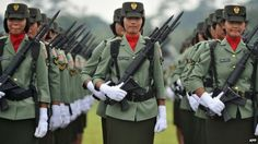 Female Indonesian soldiers stand in formation in Jakarta (file picture)  I wonder if the men are subjected to a male virginity test. They should be but I'll bet they aren't.  A bad habit?!