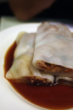 Rice Flour Rolls with BBQ Pork – Slippery, moist and thin rice noodle wrapped around piquant, slightly sweet char siu, served with a bit of sweet soy sauce.   http://myamusedbouche.com/2012/10/31/dimdimsum/