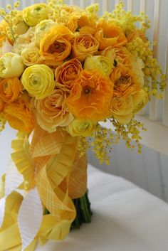 wedding flower bouquet, bridal bouquet, wedding flowers, add pic source on comment and we will update it. www.myfloweraffair.com can create this beautiful wedding flower look.    Ranunculus, Mimosa, Roses  Just Bloomed