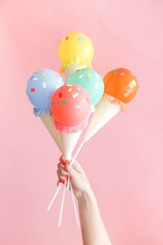 Mini Ice Cream Balloon Sticks look great as centerpieces for a party.via Oh Happy Day.