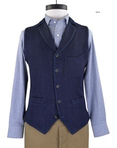 Indigo Heavy Sashiko Jacket waist coat from Luxire in its Japanese weave uplifts the indigo affinity.  Features: Welt pockets, back copper rivets and notch collar.