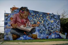 Reading: A Journey. This huge mural was created by Donald Gensler, and can be seen in Philadelphia.  The mural is a part of The Mural Arts Program that has created more than 3,000 paintings representing important aspects of Philadelphia's African American history. ⇢ Credits and more info.