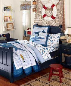 Shark Bedding! Love this little boys room , from the Navy Blue Bed and the Shark sheets, what lil guy wouldn't like this. The Fish net on the Wall and just glue some Sea Animals for a Great look. Love the Book Shelves too!