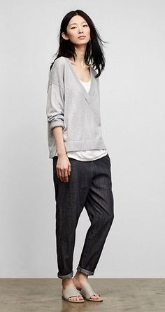 lightColors darkColors greyColors neutralColors cottonMaterial longSleeveTop trousersBottom minimalStyle casualOccasion briskWeather minimal simple trousers sweater cozy grey