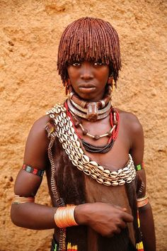 Hamer tribe woman in South West Ethiopia.  Traveler's Photos Capture the Beautiful Diversity of Remote Cultures Around the World.