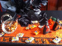 Fall/Halloween Table Decor  Use candy corn to fill a vase, then tissue paper and black roses.  Candy is a must strewn about the table!  www.eclectic-entertaining.com