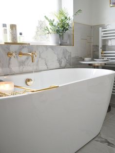 bathroom reno deep freestanding bath with 1 side attached to wall: Melissa Freestanding B Family Bathroom, Modern Bathroom, Small Bathroom, Master Bathroom, Small Freestanding Bath, Bathroom Ideas, Bathroom Tubs, Bedroom With Bath, Marble Bathrooms