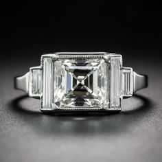 2.17 Carat Art Deco Style Diamond Ring. Sophisticated elegance radiates from this fabulous Art Deco diamond dazzler, newly rendered in platinum recreating the design and using all of the diamonds from the original (but worn out) ring. The ring showcases a gorgeous square emerald-cut diamond, weighing 2.17 carats...The scintillating stone is bordered with long, slender straight baguette diamonds which span the entire width of the ring and step down to smaller straight baguettes...