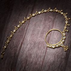 Sometimes presented by the bride's mother, the Nath is a tradition that modern brides are embracing. Nath Nose Ring, Nose Ring Jewelry, Bridal Nose Ring, Indian Jewelry Earrings, Jewelry Design Earrings, Gold Earrings Designs, Indian Wedding Jewelry, India Jewelry, Nose Rings