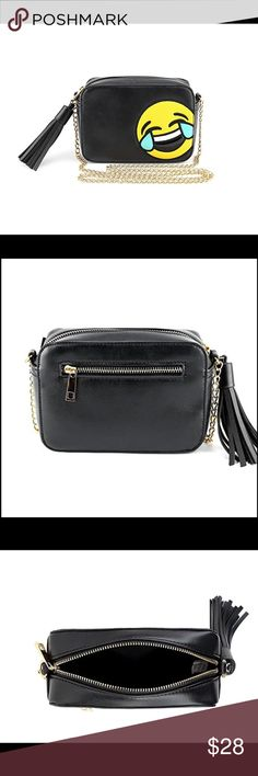 Olivia Miller LOL Camera Emoji Bag New Includes One Olivia Miller LOL Camera Emoji Bag Features the LOL emoji face on the front cover, black background, and chain shoulder strap. Includes a zippered main compartment, small back and inner zippered compartments. Perfect accessory for everyday use, school, work, and more. Ample space to fit cell phone, wallet, keys, and other small items. Dimensions: 7.7 x 6.2 x 2.8 inches Olivia Miller Bags Crossbody Bags