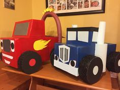 Monster trucks Blaze and Crusher made from cardboard boxes