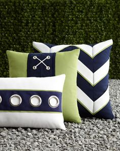 Like the oversize grommets on the front pillow - but would have used a contrasting color behind them - like the lime green.