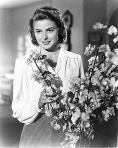 Ingrid Bergman arranging flowers...