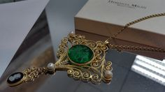 Green glass intaglio in 10K gold filigree setting and accentuated with an onyx cameo dangle and freshwater seed pearls