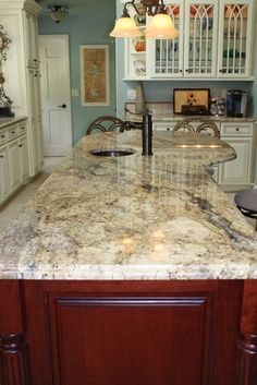 this counter top (I have a similar color) with yellow onyx back splash, rich mahogany cabinets, and stainless steel appliances