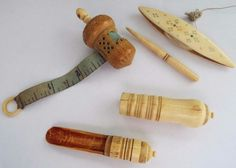 """ANTIQUE 19th C. CARVED ACORN BOVINE BONE TAPE MEASURE, SHUTTLE,PUNCH & OTHER? A charming miniature carved bone acorn tape measure circa 1850 or possibly earlier. It measures approximately 2½"""" long including the knot to the winding spool and it has been beautifully made with the original silk tape intact. This has some damage to the center of the acorn where it has been intricately carved. The tape spool winds easily. It has been very nicely carved and shaped. A suburb tatting shuttle which"""
