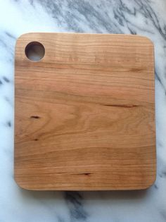 Maple Cutting Board Made from 100% salvaged wood.  Size: 8 inch length, 7.25 inch width, .75 inch depth Materials: Natural oil treated maple