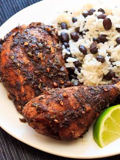 Jamaican Jerk Chicken with Coconut Rice and Beans.  Amazing chicken!!  I used chicken breasts instead of thighs/drumsticks. Blackened the chicken & served it with the beans & rice, a fruit salad (felt like some fresh fruit tonight), and garnished the rice with pineapple salsa.  Flavor explosion! New favorite meal.  The kids & Chad loved it too!!