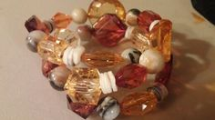 Acrylic crystal designed beads with mother of pearl heshi and agate rounds in a wrap bracelet