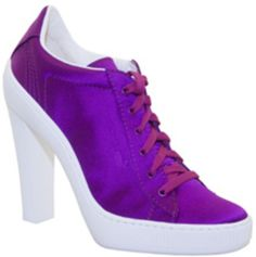 In 2008, Puma and Sergio Rossi collaborated on a collection to be sold at Colette. They are sneaker heels.  We are not sure where someone would wear sneakettos, but we do know that considering the purple satin lace-ups and Mary-Janes with gummy white soles, we won't be wearing this collection anytime soon.  Although we love the Sergio+Puma=sneakers concept with Colette, it would definrtely be up to the consumer if they would wear this type of sneaker/shoe, would you?