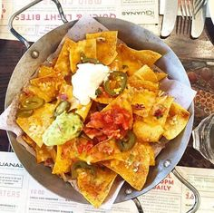 Spice-dusted corn tortilla chips, with melted cheese, topped with pico de gallo, jalapeños, salsa, sour cream & guacamole.