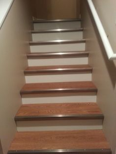 Lovely Allure Vinyl Plank Flooring On The Basement Stairs