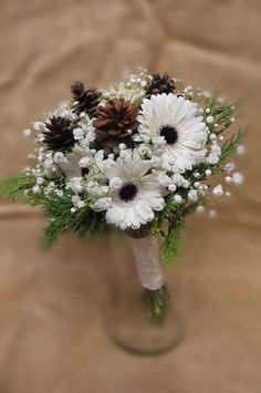 Beautiful, Winter Wedding Bouquet Made by Perfect Petals Florist and Decor in Cecil County MD. 410-287-0870 or 410-658-1326