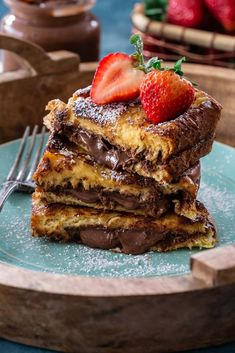 Sometimes we just need to start the day with something decadent and indulgent, like this Nutella French Toast! Made with brioche bread and stuffed with Nutella, it's the perfect treat for a special breakfast-in-bed on Toast Nutella French Toast Brioche French Toast, French Toast Rolls, Nutella French Toast, Best French Toast, Brioche Bread, Cinnamon French Toast, French Toast Bake, Stuffed French Toast, French Toast Recipes