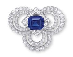 A SAPPHIRE AND DIAMOND NECKLACE-BROOCH, BY CARTIER