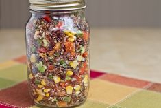 Red Quinoa and Black Bean Vegetable Salad  Light, fresh, and packed with protein and healthy fats, this tangy salad will have you dreaming of Spring and Summer.