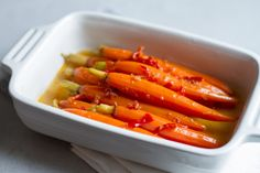 Sous Vide Baby Carrots Glazed with Harissa and Maple Syrup - Harissa, a Middle Eastern chili paste, plays perfectly with maple syrup on these sous vide baby carrots. This simple preparation makes for a perfect, slightly spicy side dish. Carrot Recipes, Vegetable Recipes, New Recipes, Vegetarian Recipes, Cooking Recipes, Tasty Dishes, Side Dishes, Main Dishes, Sous Vide Vegetables