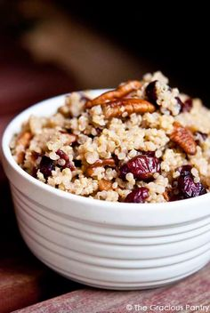 4 cups cooked quinoa, cooked with unsweetened almond milk, cooled* 1 cup juice sweetened, dried cranberries 1 cup pecan pieces 1/2 tsp. cinnamon 2 tbsp. honey 4 tbsp. fresh lemon juice
