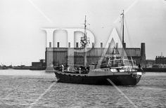 With her cargo of 600 tonnes of foodstuff, drugs and blankets for famine ridden Biafra, the Irish mercy ship Columcille sails out of Dublin, with Captain P. O'Saeghdha in command and a crew of 12, among which is a seaman priest, Rev. Fr. Joseph Fitzgibbon, the Limerick born Holy Ghost Father, who has volunteered as third engineer on the vessel. The ship sails out of Dublin Port. 06.09.1968 see more photos at: www.irishphotoarchive.ie #boats #ireland #oldphotos #irishphotoarchive… Holy Ghost, Photo Archive, Priest, Engineer, More Photos, Dublin, Drugs, Joseph, Boats