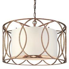 An elegant openwork overly and a classic white drum shade make this pendant an eye-catching illumination. Suspend it in the foyer to welcome guests with elegant appeal, or hang it above your dining room #pendant #shade #eye