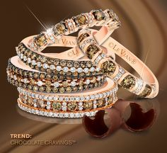A group of Chocolate Diamonds® & Vanilla Diamonds® stackable bands in Strawberry Gold®. How many would you stack on?
