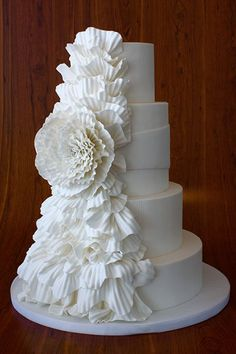 This ruffled look resembles crepe paper gathered into a flower.Cake by Elegantly Iced