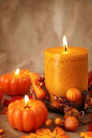 Photo about Autumn candles on a brown backdrop. Image of group, vertical, orange - 10577865