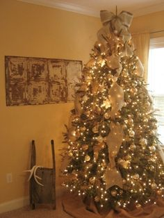 Burlap Christmas - Living Room..Love the burlap bow and letting it trail down the tree! @Brenda Franklin Granger