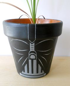 Darth Vader and other Star Wars painted flower pots via Etsy.