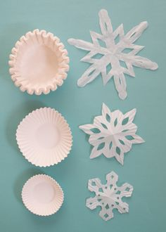 9 Festive Uses For Coffee Filters This Holiday Season - Apartment Therapy - 9 Festive Uses For Coffee Filters This Holiday Season Coffee Filter Holiday DIY Decorating Ideas Paper Snowflakes Easy, Snowflakes For Kids, Coffee Filter Crafts, Coffee Filters, Black Christmas, Christmas Crafts, Christmas Ideas, Snow Flakes Diy, Origami Paper