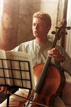 "David Bowie playing the cello. ""I always had a repulsive need to be something more than human."" . . . ""I don't know where I'm going from here, but I promise it won't be boring."""