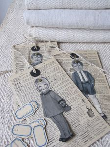 Tags made from encyclopedia pages and vintage children's clothing advertisements.