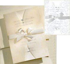 With an absolutely breathtaking design, these gorgeous printable Laura Ashley Wedding Invitations arrive in a kit that contains everything you need to leave your recipients speechless. Each invitation is surrounded by a vellum floral wrap tied closed by a satin ribbon to create layers of total elegance. You control the look, text, and font of your invitations by following the easy step-by-step guidelines included with each set. Also included are coordinating envelopes as well as response…