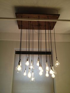 Bespoke Urban Chandelier with varying bulbs by urbanchandy on Etsy, $575.00